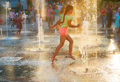 Beautiful girl in a fountain Royalty Free Stock Image