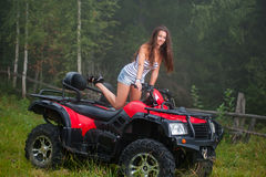 Beautiful girl on four-wheeler ATV stock photos