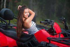 Beautiful girl on four-wheeler ATV Stock Photo