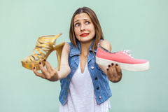 The beautiful girl with freckles in mall got choosing sneakers or handsome shoes, thinking and looking up Stock Photos