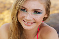 Beautiful girl with freckles over her face Stock Photography