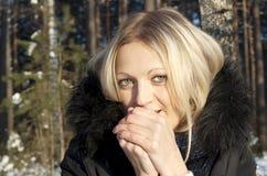 Beautiful girl freezes in nature Stock Photos