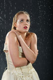 Beautiful girl freezes in rain Royalty Free Stock Image
