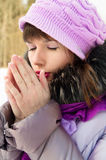 Beautiful girl freezes in winter Stock Images