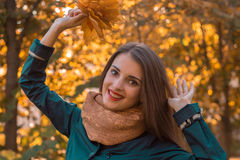 Beautiful girl in frenzy Scharfe raised his hands up and laughs close- Stock Image