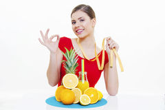 Beautiful girl with fresh fruit juice Royalty Free Stock Photography