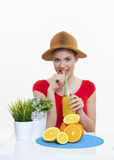 Beautiful girl with fresh fruit orange lemon juice. Beautiful girl with orange lemon juice for good health and immunity booster diet for fit body smiling on royalty free stock photography