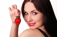 Beautiful girl with a fresh juicy strawberry Stock Images