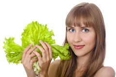 Beautiful girl with fresh lettuce isolated Royalty Free Stock Photos