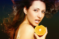 Beautiful girl with fresh orange Royalty Free Stock Photography