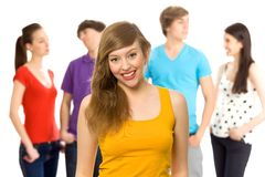Beautiful girl with friends. Young girl with friends in background Stock Photos