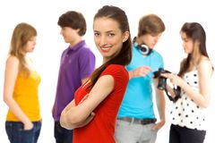 Beautiful girl with friends. Young girl with friends in background Royalty Free Stock Images