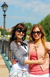 Beautiful girl friends. Portrait of the beautiful girls in a park in Moscowl city Royalty Free Stock Image