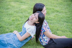 Beautiful girl friends in park. Beautiful asian girl friends smiling in park Royalty Free Stock Photo