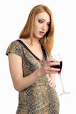 Beautiful girl frowns on alcohol Stock Photography