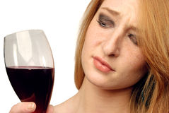 Beautiful girl frowns on alcohol Royalty Free Stock Photo