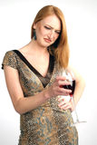Beautiful girl frowns on alcohol Royalty Free Stock Image