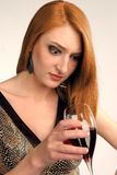 Beautiful girl frowns on alcohol Royalty Free Stock Photos