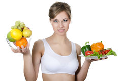 Beautiful girl with fruit and vegetables Stock Photography