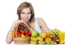 Beautiful girl with fruit and vegetables Royalty Free Stock Images