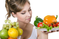 Beautiful girl with fruit and vegetables Stock Photos