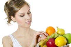 Beautiful girl with fruit and vegetables Stock Images