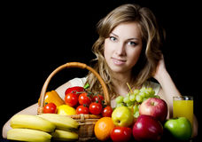 Beautiful girl with fruit and vegetables Royalty Free Stock Photos