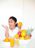 The beautiful girl with fruits Royalty Free Stock Photos