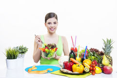 Beautiful girl with fruits and vegetables healthy diet. Beautiful girl holding fresh salad of fruit and vegetable for good health and immunity booster diet for stock photo