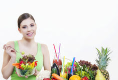 Beautiful girl with fruits and vegetables healthy diet. Beautiful girl holding fresh salad of fruit and vegetable for good health and immunity booster diet for stock images