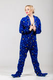 Beautiful girl in funny pajamas undressing Royalty Free Stock Photos