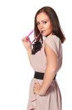 Beautiful girl with funny pink eyeglasses Stock Image