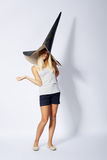 Beautiful girl with funny wizard hat. Photo of beautiful girl with funny wizard hat Royalty Free Stock Photography