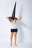 Beautiful girl with funny wizard hat Stock Photos