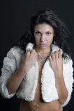 BEAUTIFUL GIRL IN THE FUR COAT Royalty Free Stock Photography