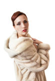 Beautiful girl in the fur coat. Royalty Free Stock Photography