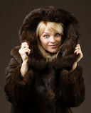 Beautiful girl in a fur coat Stock Photos