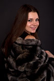 Beautiful girl in a fur coat Stock Image