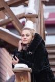 Beautiful girl in a fur coat. Stock Photos