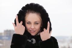 Beautiful girl in a fur coat. Royalty Free Stock Photos