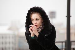 Beautiful girl in a fur coat. Stock Photo