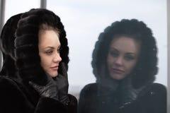 Beautiful girl in a fur coat. Royalty Free Stock Image