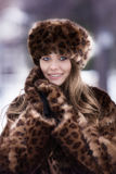 Beautiful girl in a fur coat of  leopard Stock Photography
