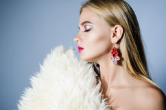 Beautiful girl with fur and ear rings, beauty Stock Images