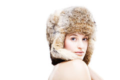 Beautiful girl in a fur hat Stock Photography