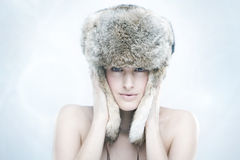 Beautiful girl in a fur hat Royalty Free Stock Photography