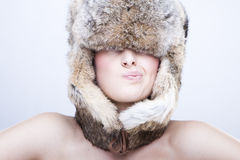 Beautiful girl in a fur hat Stock Photo