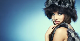 Beautiful Girl in Fur Hat. Royalty Free Stock Photos