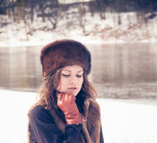 Beautiful girl in a fur hat Stock Image