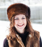 Beautiful girl in a fur hat Royalty Free Stock Photos